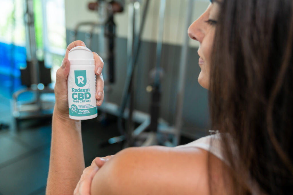 CBD pain cream for shoulder and back pain in use at the gym